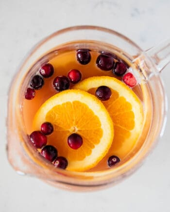 holiday punch in pitcher with orange slices
