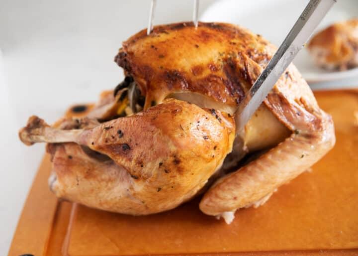 cutting turkey on cutting board