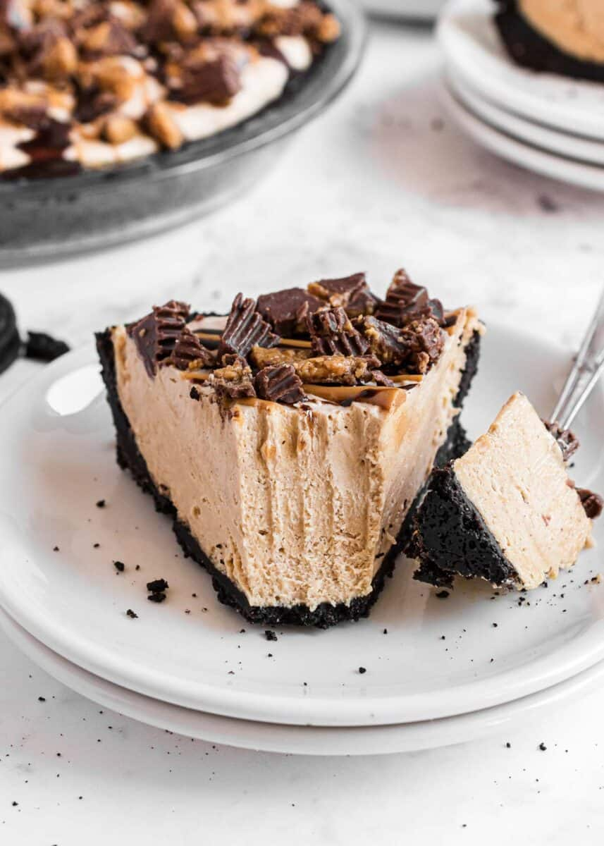 peanut butter pie with oreo crust on white plate