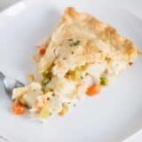 slice of turkey pot pie on white plate