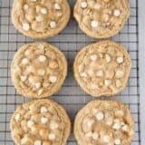 white chocolate macadamia nut cookies on cooling rack