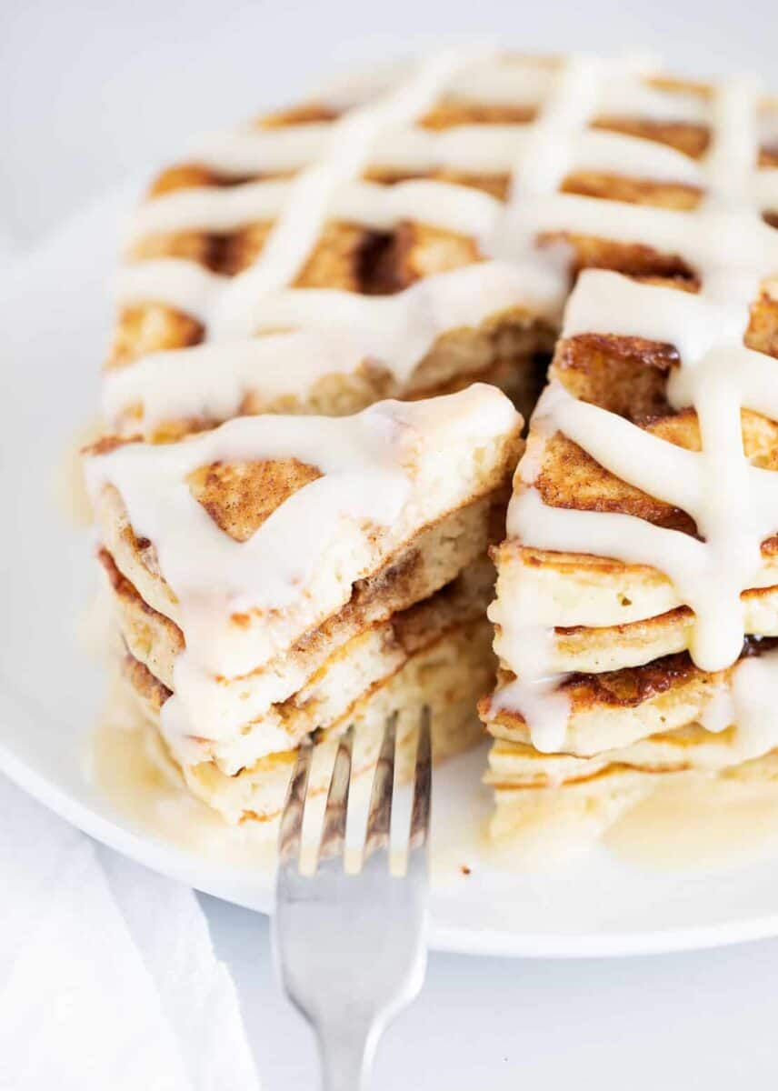close up of cinnamon roll pancakes on plate