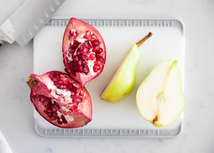 pear and pomegranate on cutting board