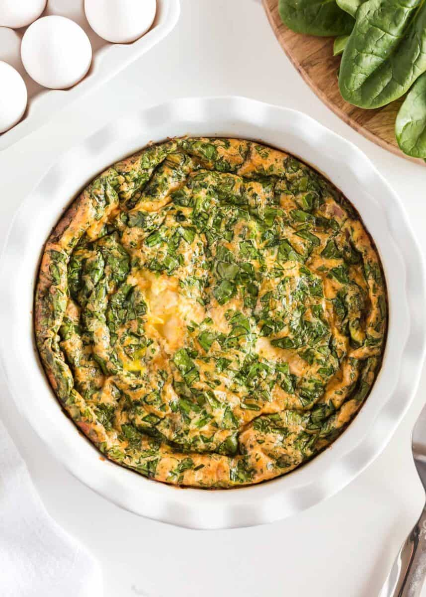 crustless spinach quiche in white pie dish