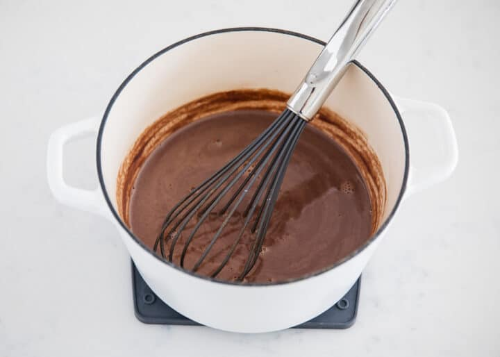 whisking hot chocolate in pot