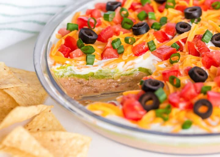 5 layer dip with toppings in glass dish
