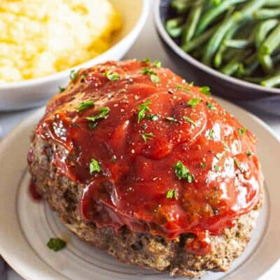 meatloaf on plate with mashed potatoes and green beans