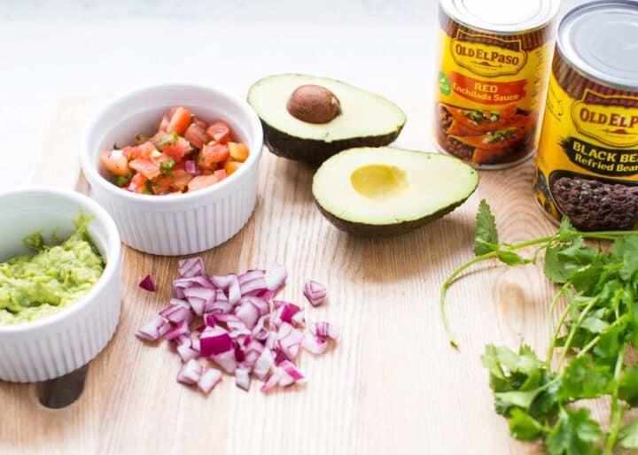 nacho ingredients on cutting board