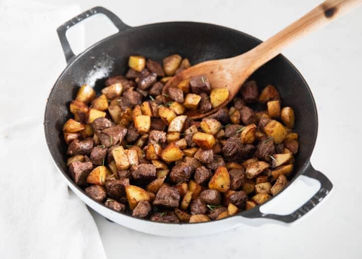 steak and potatoes in pan