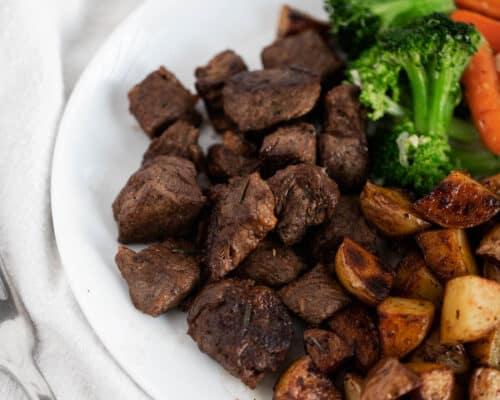 steak bites on white plate