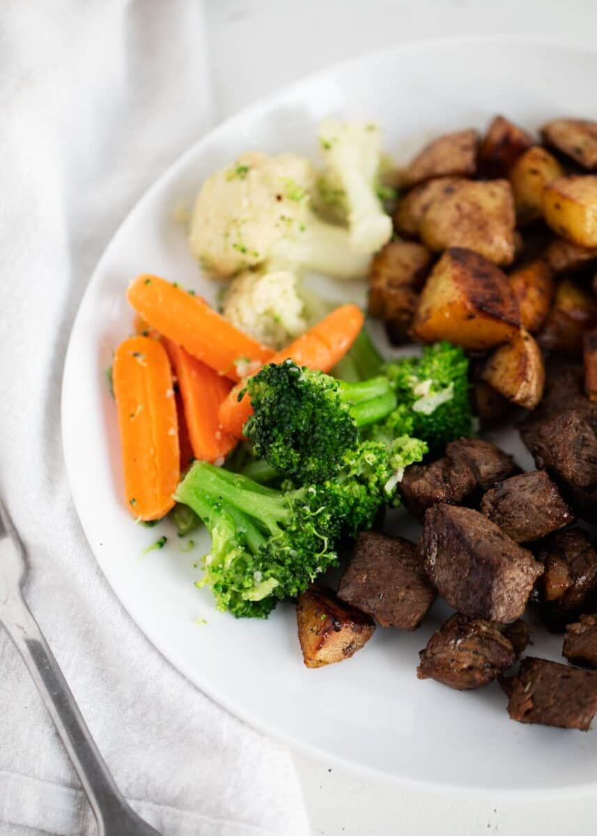 steamed vegetables with meal on plate