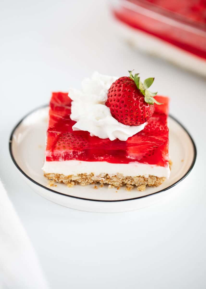 strawberry pretzel salad on white plate