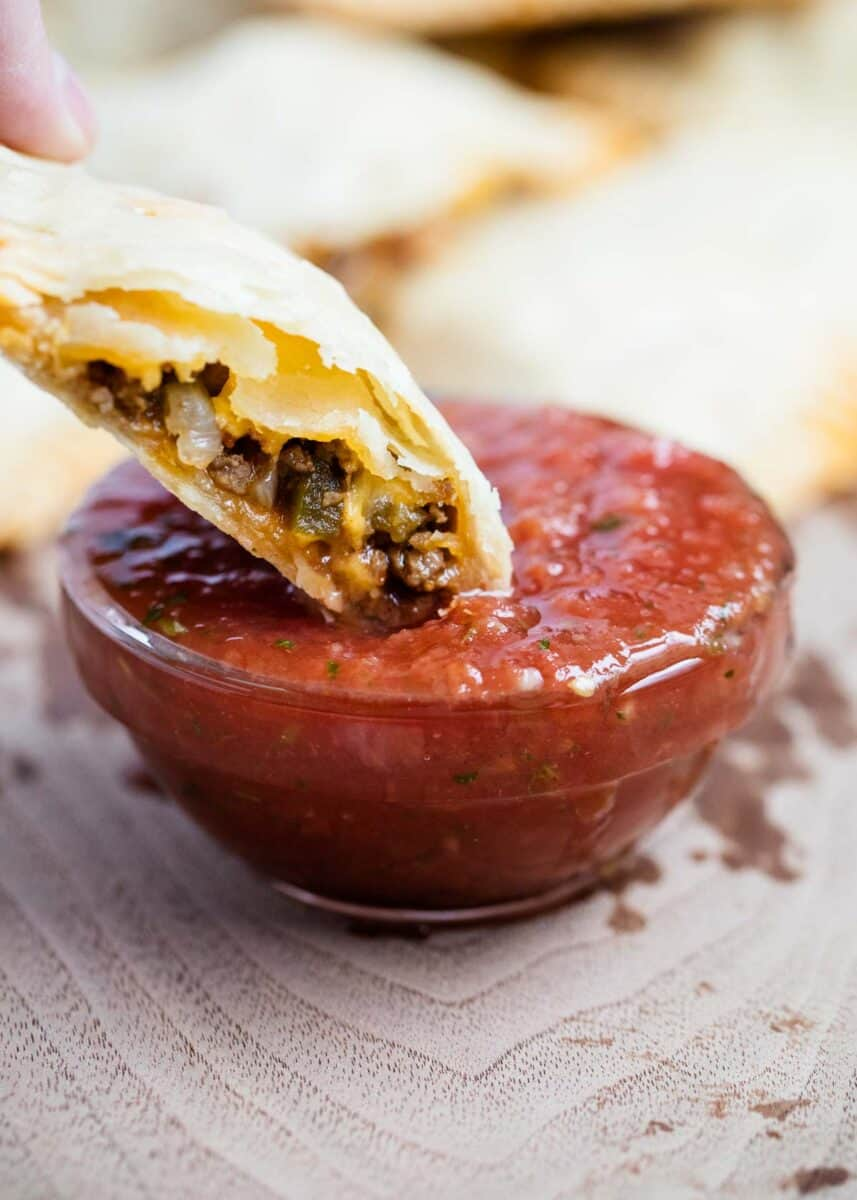dipping taco pocket in salsa
