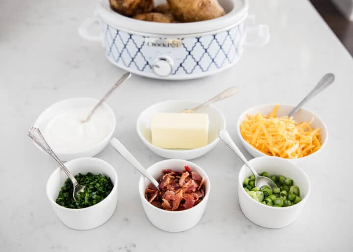 baked potato bar toppings in bowls