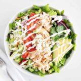 buffalo chicken salad in white bowl