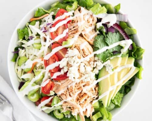 buffalo chicken salad in white bowl