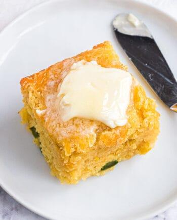 slice of cornbread on white plate