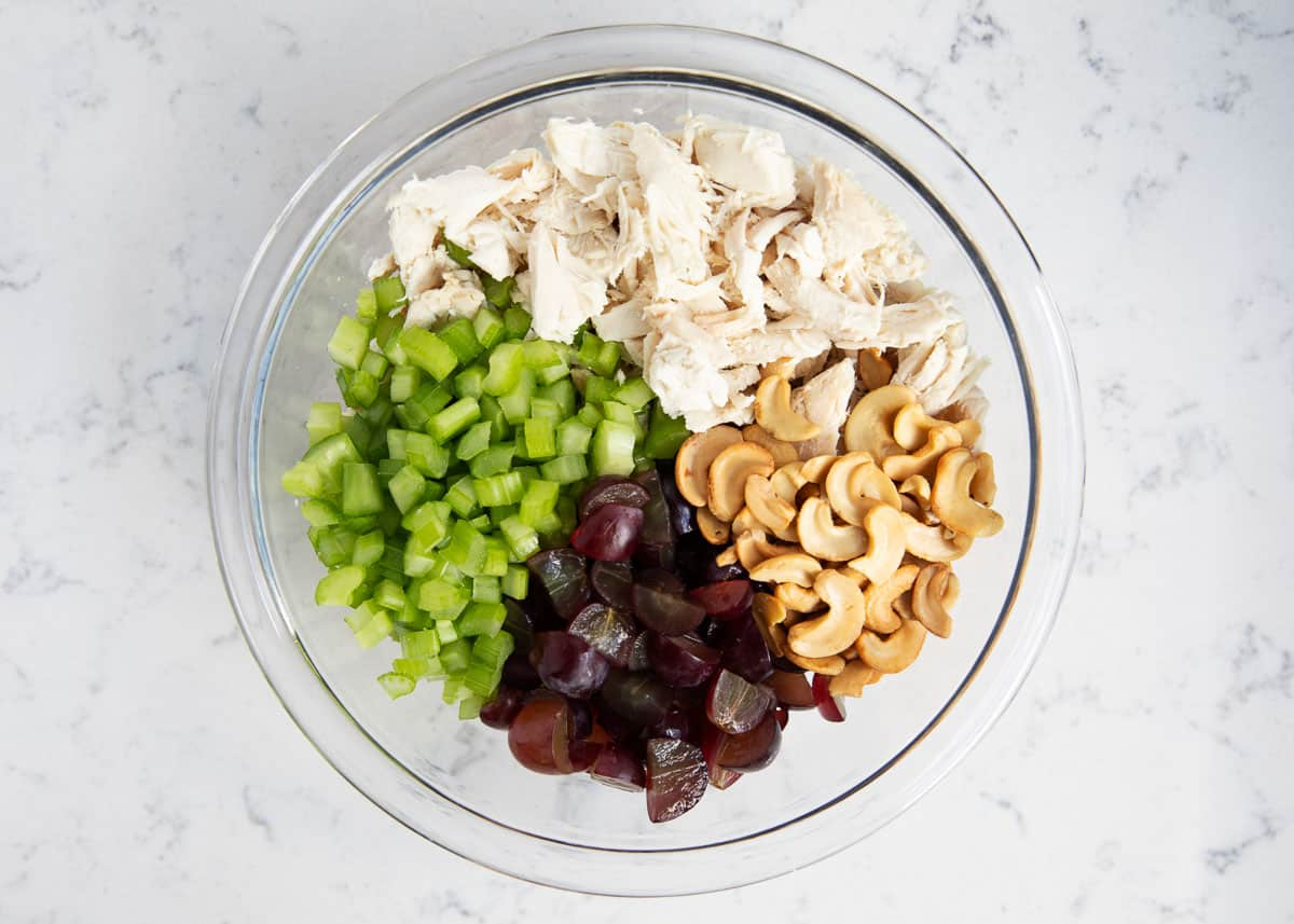 chicken salad ingredients in a glass bowl