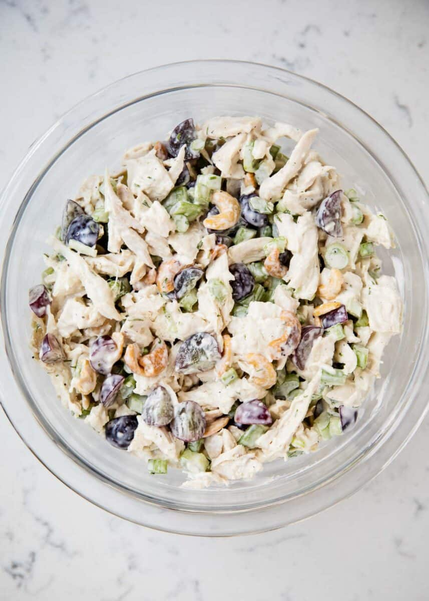 chicken salad mixed in a glass bowl