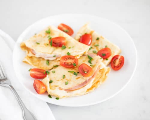 ham and cheese crepe on white plate