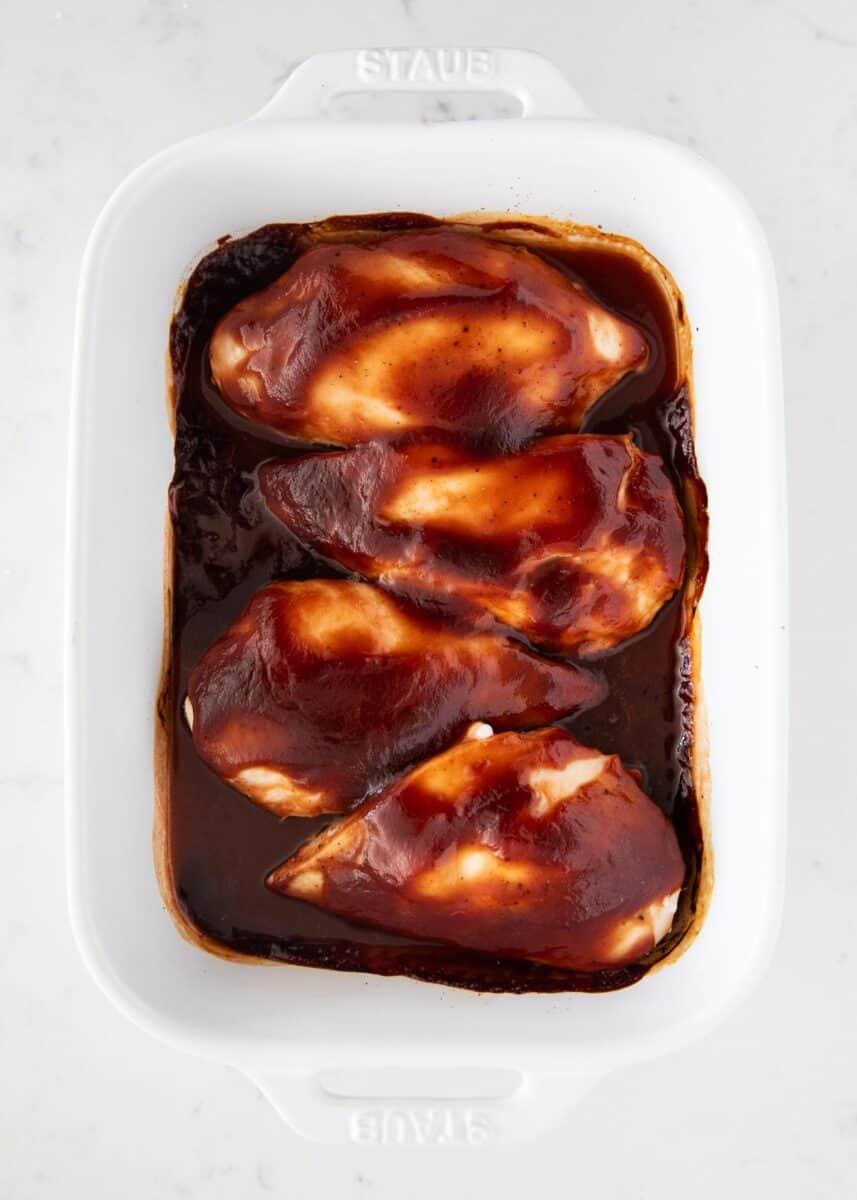 baked bbq chicken in white platter