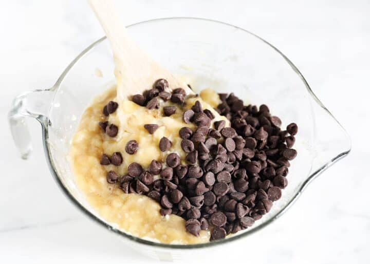 banana bread batter in bowl with chocolate chips