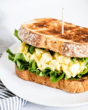 egg salad sandwich on white plate