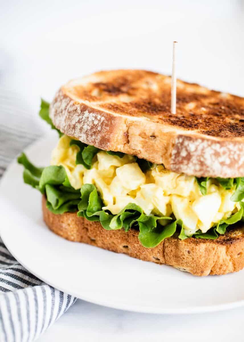 egg salad sandwich on white plate