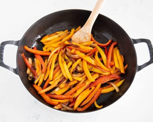 fajita veggies cooking in pan