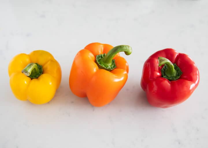 different colored bell peppers on table