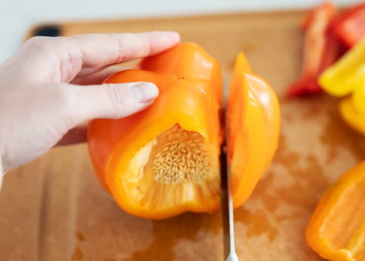 bell peppers being cut on cutting board