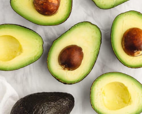 sliced avocados on counter