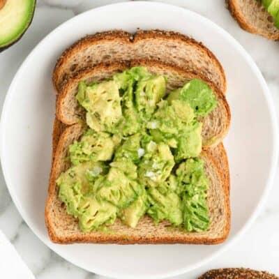 avocado toast on white plate