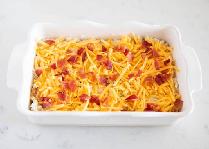 loaded baked potato casserole in white platter