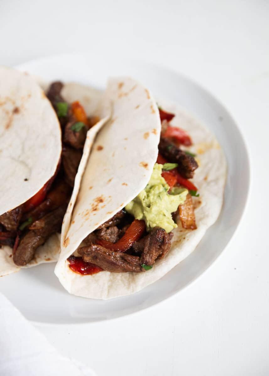 steak fajitas on white plate