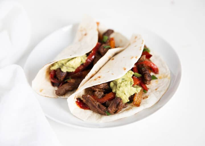 steak fajitas on white plate