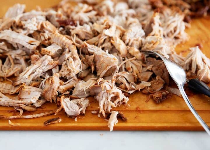 pulled pork on wooden cutting board