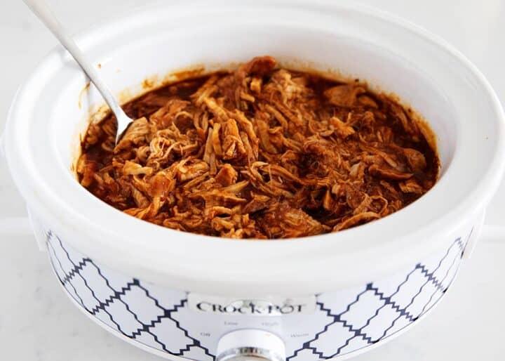 BBQ pulled pork in white crock pot