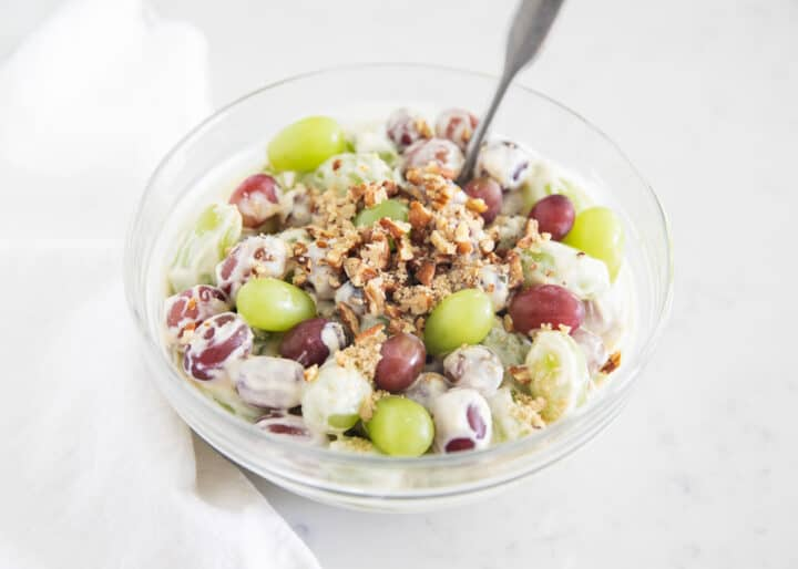 grape salad in clear bowl