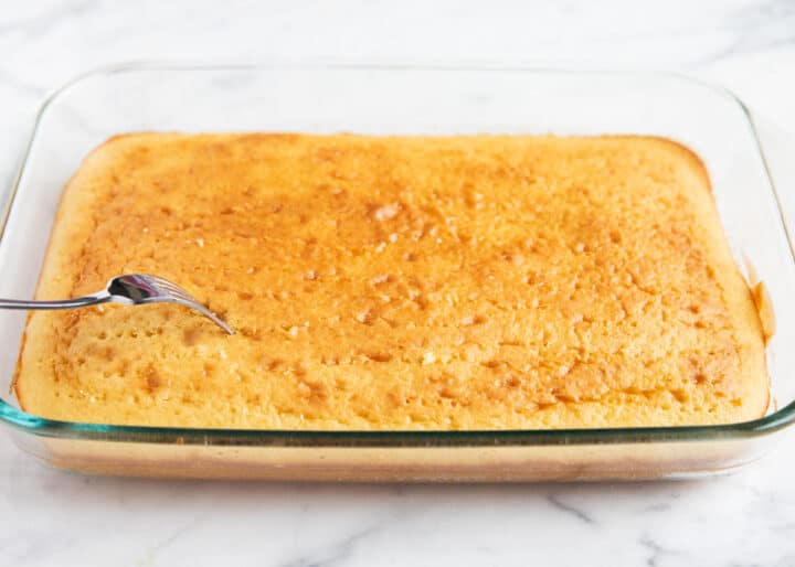 tres leches cake in clear pan