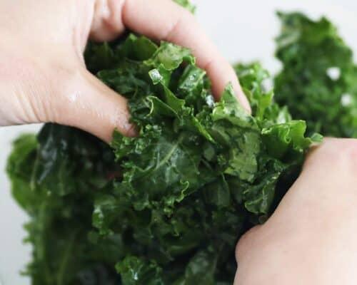 massaging kale in bowl