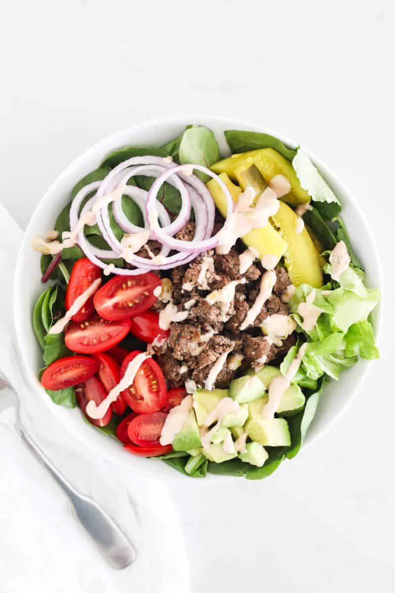 burger salad in white bowl