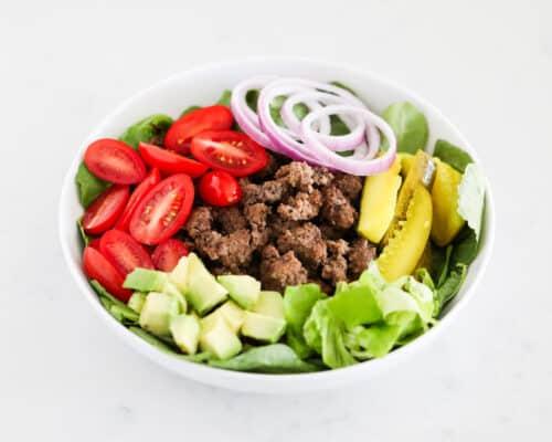 burger salad ingredients in white bowl