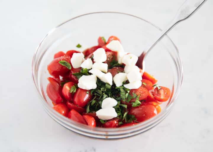 caprese bruschetta ingredients in clear bowl