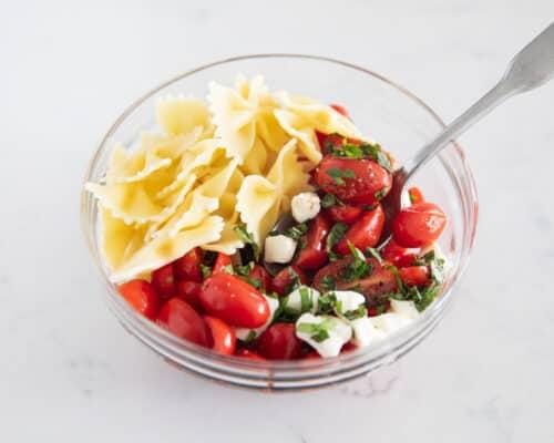 caprese pasta salad ingredients in bowl