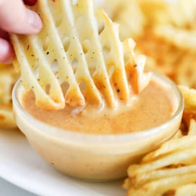 waffle fry dipped in sauce