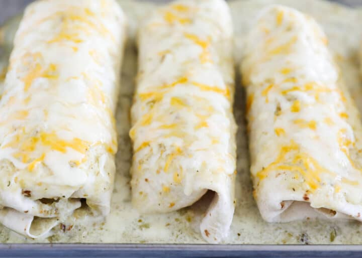 cooked chicken burritos on pan