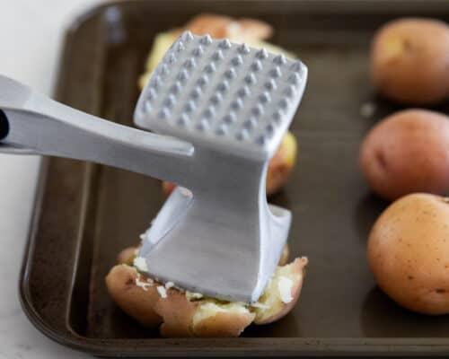 smashing potatoes on pan