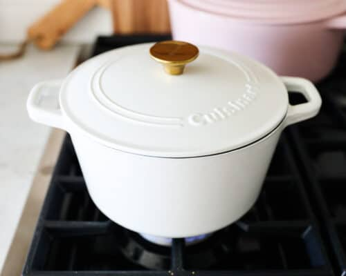rice and coconut milk in white pot cooking