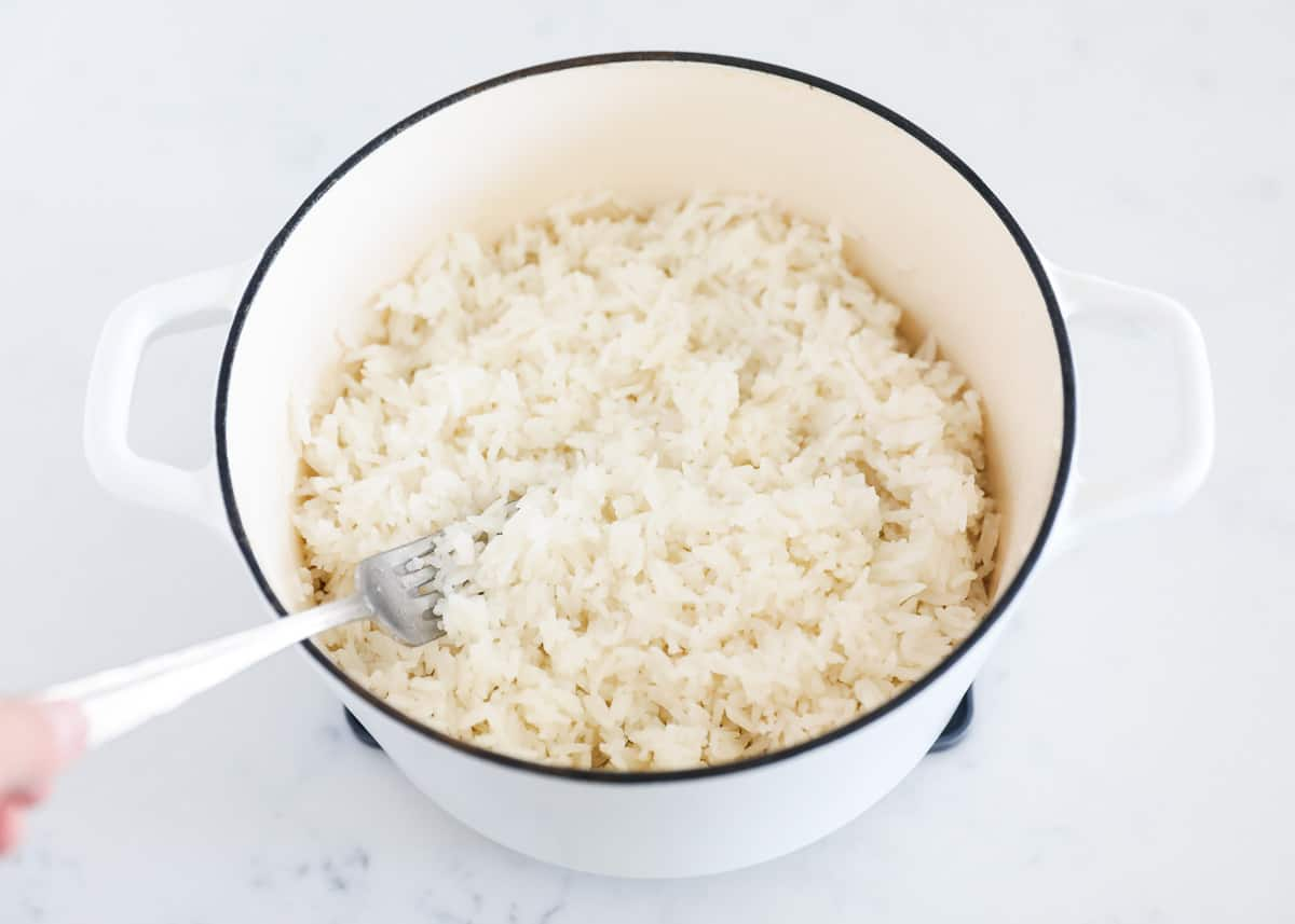 cooked coconut rice in white pot